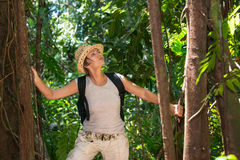 Woman hiking in tropical forest Stock Images
