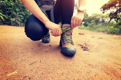 Woman hiking tying shoelace Royalty Free Stock Images