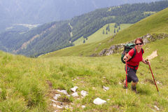 Woman hiking up a mountain Royalty Free Stock Images