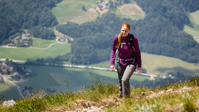 Woman Hiking Up a Mountain Stock Photography