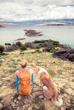 Woman hiking walking with dog on seaside trail Royalty Free Stock Photos