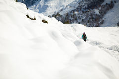 Woman hiking in white winter mountains Stock Images
