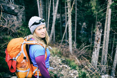 Woman hiking in winter cold dark winter forest Royalty Free Stock Photos