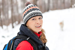 Woman hiking in winter forest royalty free stock images
