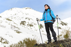 Woman hiking on winter mountain Stock Photo