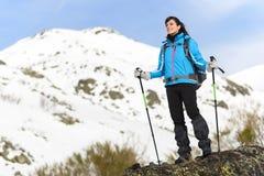 Woman hiking on winter mountain. Woman hiking trip on winter mountain. Beautiful sporty hiker caucasian traveler Stock Photo