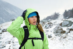 Woman hiking in winter mountains Royalty Free Stock Photos
