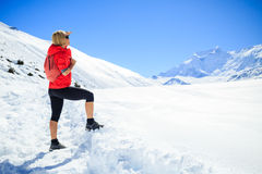 Woman hiking in winter mountains Royalty Free Stock Image