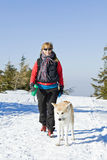 Woman Hiking With Dog In Winter Royalty Free Stock Images