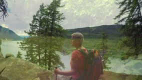 Woman hiking in the woods. Digital composite of an old Caucasian woman hiking in the woods. She is gazing at a high angle view of a lake and mountains stock footage