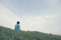 Woman on hillside Stock Photo