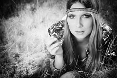 Woman hippie. Beautiful young woman hippie posing outdoor stock images
