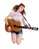Woman in hippie outfit jumping Royalty Free Stock Image
