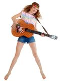 Woman in hippie outfit jumping Stock Photo