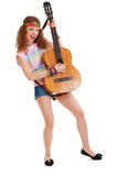 Woman in hippie outfit playing on guitar Royalty Free Stock Photos