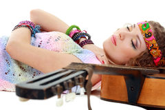 Woman in hippie outfit sleeping Stock Images