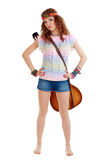 Woman in hippie outfit standing with guitar Stock Images