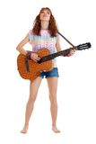 Woman in hippie outfit standing with guitar Stock Photos