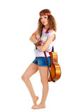 Woman in hippie outfit standing with guitar Royalty Free Stock Image
