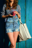 Woman Hipster with Linen Bag keep in their hands disposable cup with Smoothies Stock Images