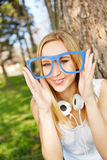 Woman with hipster nerd glasses in summer Royalty Free Stock Image