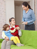 Woman hires governess for her child Stock Images