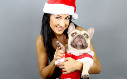 Woman And His French Bulldog In Christmas Costume. Beautiful woman and his french bulldog in christmas costume stock image