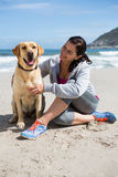 Woman with his pet dog. On beach Stock Images