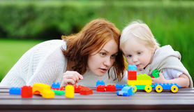 Woman with his son playing with colorful plastic blocks Royalty Free Stock Photo