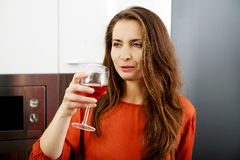 Woman with his wineglass in the kitchen. Royalty Free Stock Images