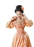 Woman in Historic Baroque Costume Corset, Girl Rococo Retro. Woman in Historic Baroque Costume Corset, Girl in Rococo Retro Style Dress Flirting Isolated Over Royalty Free Stock Photo