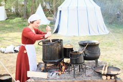 Woman in historical kitchen Royalty Free Stock Images