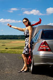 Woman hitch-hiking Royalty Free Stock Images