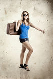 Woman hitch hiking Stock Images