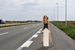 Woman hitchhike. Adult woman hitchhike on highway Royalty Free Stock Image