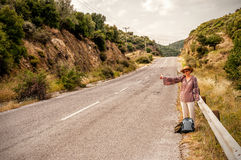Woman hitchhiker Royalty Free Stock Images