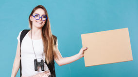 Woman hitchhiking with blank sign for your text. Stock Photos