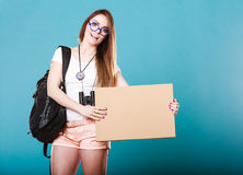 Woman hitchhiking with blank sign for your text. Stock Image