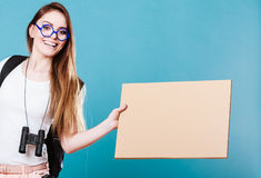 Woman hitchhiking with blank sign for your text. Royalty Free Stock Photography