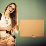 Woman hitchhiking with blank sign for your text. Royalty Free Stock Images