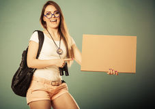 Woman hitchhiking with blank sign for your text. Royalty Free Stock Image