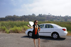 Woman Hitchhiking Broken Car Stock Photos