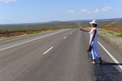 Woman hitchhiking Outback Stock Image