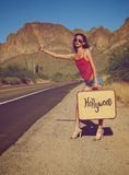 Woman hitching a ride Stock Photography
