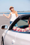 Woman hitching a ride. Royalty Free Stock Image