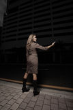 Woman hitching a ride in the dark Royalty Free Stock Image