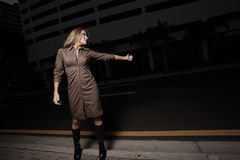 Woman hitching a ride in the dark Stock Photo