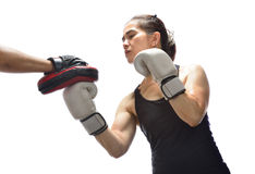 Woman hitting boxing Stock Photo