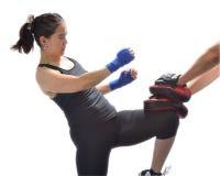 Woman hitting boxing Stock Photo