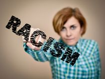 Woman against racism. Woman hitting and breaking word racism with her fist. Selective focus Royalty Free Stock Images